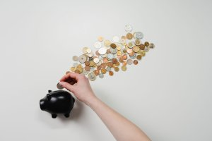coins piggy bank spending saving shifted