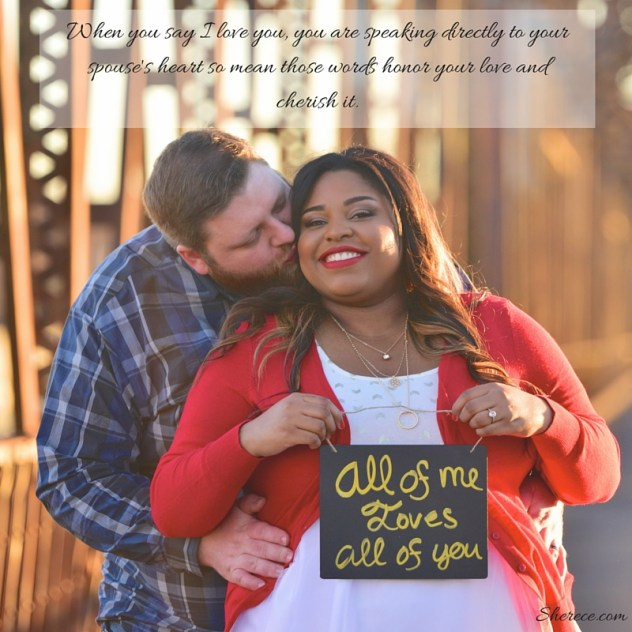 "Cute couple with man holding woman from behind she holds a sign that reads ""all of me loves all of you"" and the quote reads ""When you say I Love You, you are speaking directly to your spouse's heart so mean those words honor your love and cherish it."""