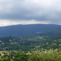 Rain clouds gather over the hills