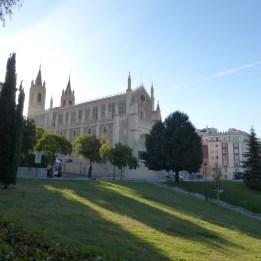 The church casts shadows in the Prado grounds