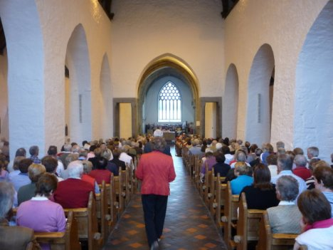 Congregation in main aisle of Holycross Abbey