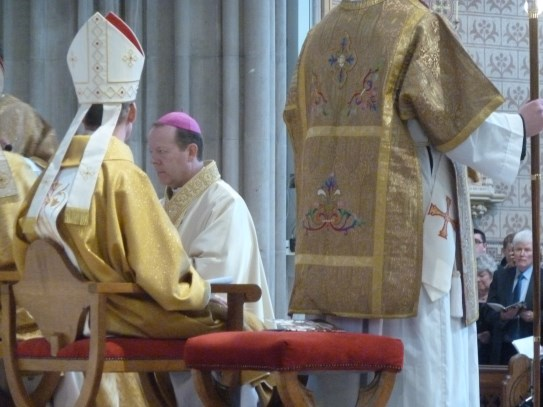 Receiving the insignia of being a bishop - mitre, crozier and ring