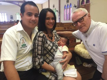 Little boy with his parents and the priest after Sunday Mass in Honduras (November 2016)