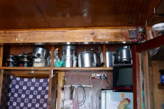 Pressure cookers line the shelf