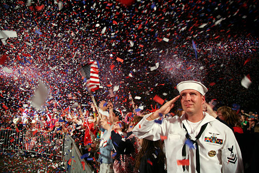 BOSTON, Mass. (July 4, 2009) Mass Communication Specialist 2nd Class Scott Webb salutes as the American flag is presented on stage during the Boston Pops Fireworks Spectacular at the Charles River Esplanade. By U.S. Navy photo by Senior Chief Mass Communication Specialist Gary Ward [Public domain], via Wikimedia Commons