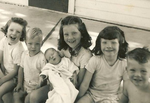 Gwen, holding Baby Tina with some of her siblings
