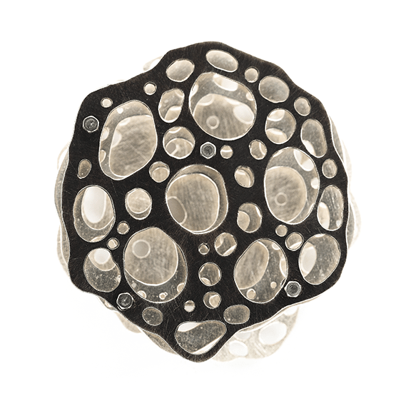 Three layer recycled sterling silver necklace based on a radiolarian drawn by Ernst Haeckel in 1862.
