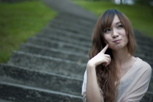 chinese-girl-sitting-on-steps-making-a-silly-face-pv
