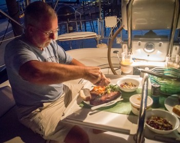 Bob sits down to a dinner of pork tenderloin in the cockpit...