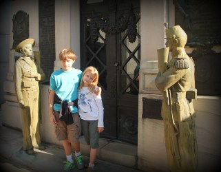 A military tomb guarded by sailor and soldier statues