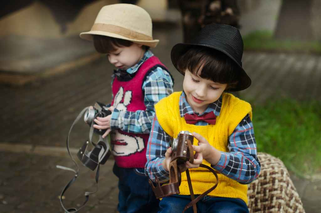 two boys holding camera
