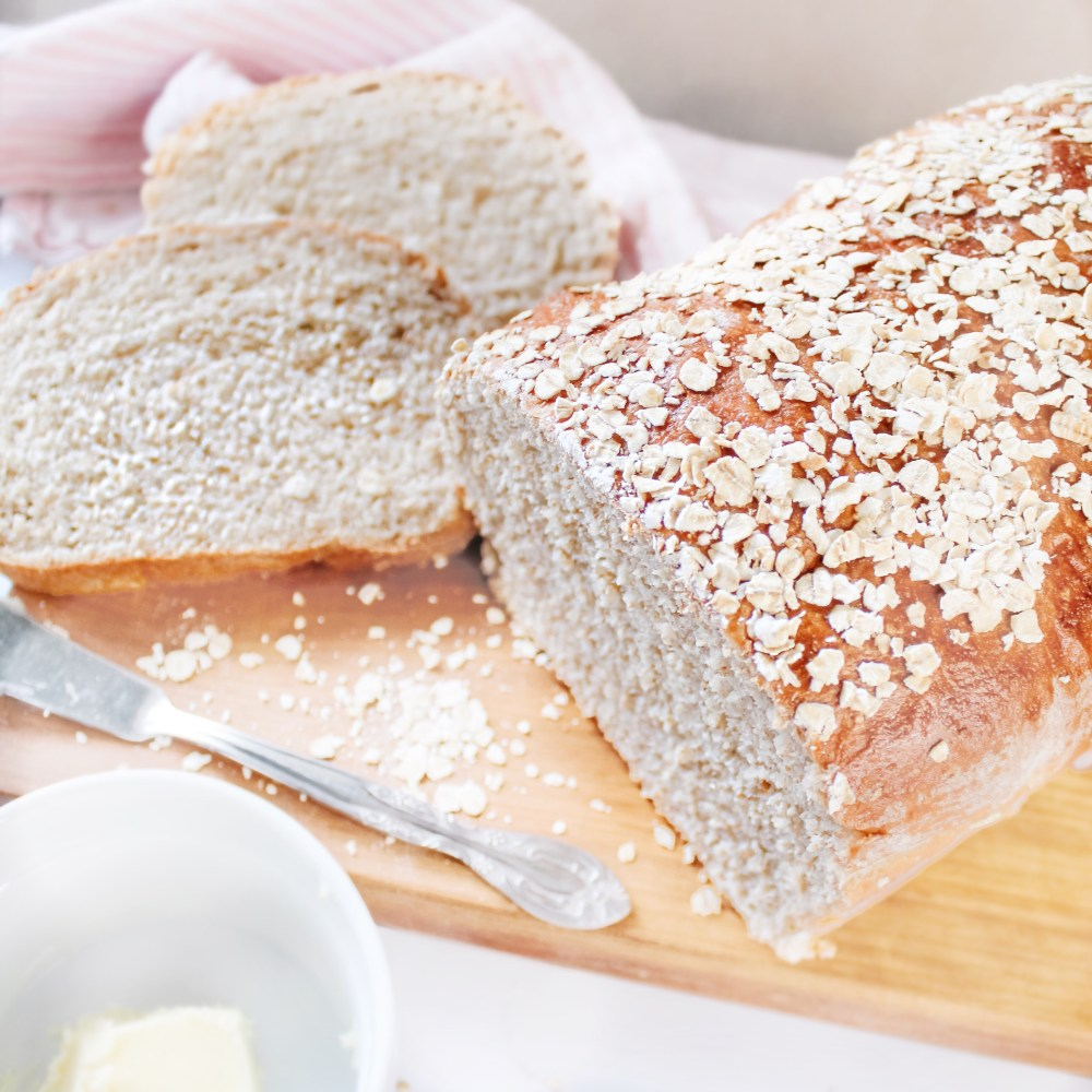 Best Whole Wheat Oats and Honey Bread Recipe - hearty whole wheat bread with the sweet taste of honey tops with rolled oats
