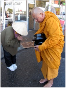 A woman bowing to a monk in Little Saigon