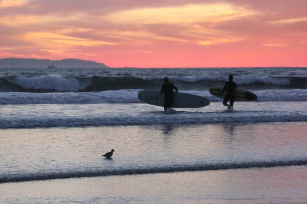 Huntington Beach, California, beach sunset, surfers at sunset