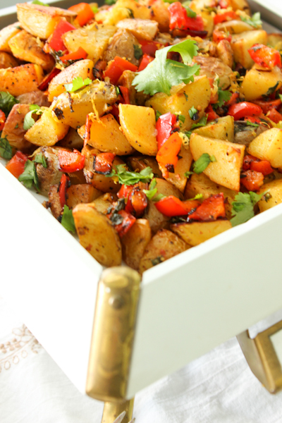 Middle Eastern spiced potatoes in retro white serving dish
