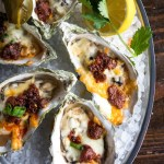 Broiled Oysters with Mexican Cheeses, Chorizo, Green Onions and Jalapeno