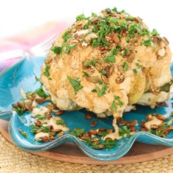 Whole Roasted Cauliflower with Pumpkin Seeds and Curry Tahini Sauce | ShesCookin.com