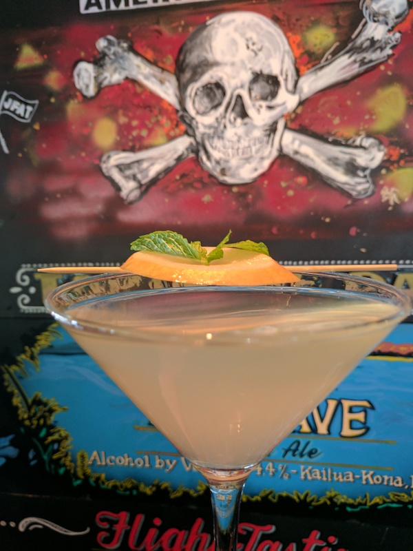 Pear Vodka Martini with skull and crossbones background