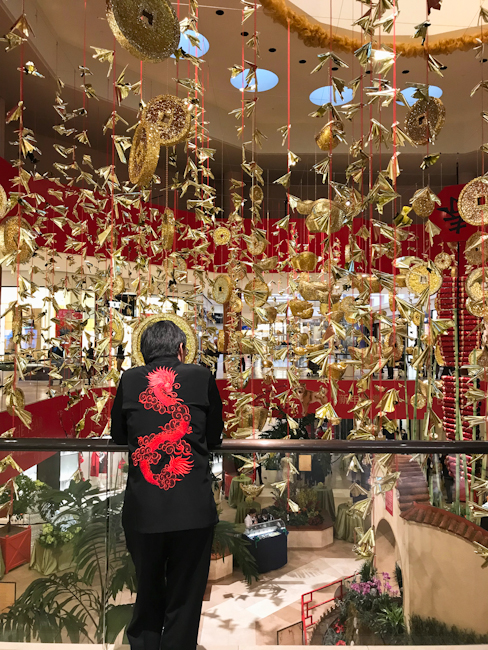 Gold coins suspended from ceiling of Jewel Court at South Coast Plaza