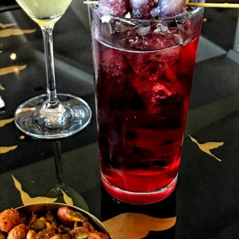 Purple Rain cocktail garnished with frozen grapes at Montage Laguna Beach
