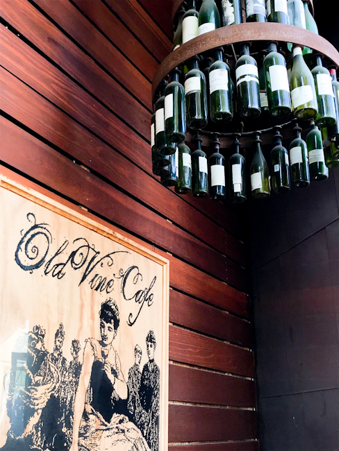 Old Vine Cafe sign and hanging wine bottle chandelier