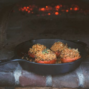stuffed tomatoes in a cast iron skillet