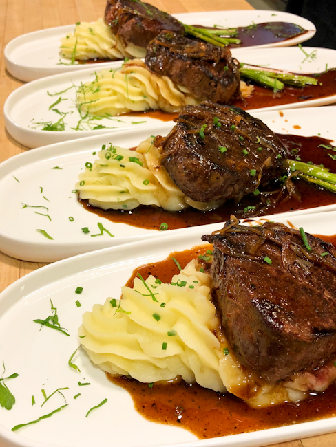 Plates of Steak with demi glace and mashed potatoes at The Essex Cook Academy