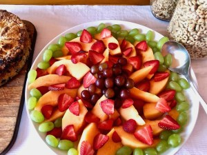 platter of fresh strawberries, grapes and peaches