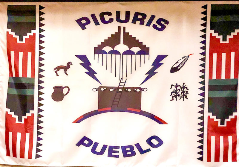 Native American pueblo culture, Hotel Santa Fe woven tapestry of the Picuris Pueblo flag