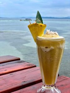Pina Colada on the deck overlooking the Caribbean