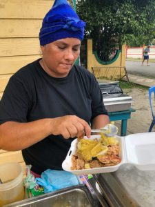 Street vendor serving Panamian fried fish in Bocas Town
