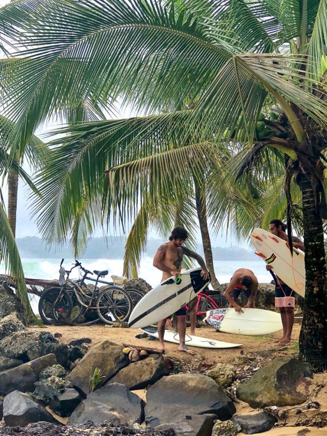 Surfers at Paki Point, Bocas del Toro, Panama