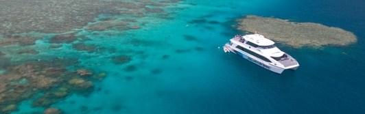 A Quicksilver cruise ship driving through the reef