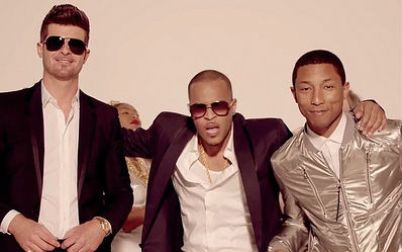 Robin Thicke, TI and Pharrell performed 'Blurred Lines'. Image credit: http://thompsonhall.com/copyright-lawsuit-blurred-lines/
