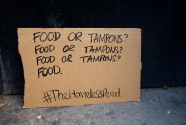 Cardboard placard part of #TheHomelessPeriod campaign