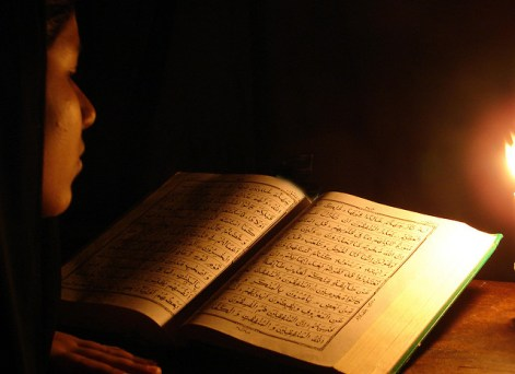 Woman reciting Qur'an
