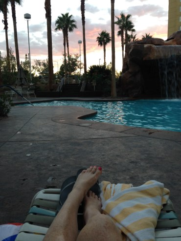 Mom time with a book by the pool as the sun goes down