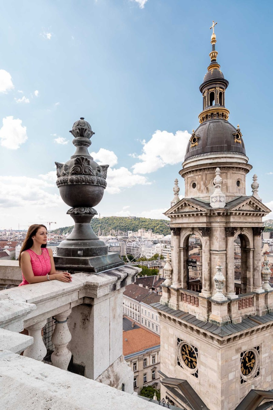 Girl in pink dress standing on the top of the St. Stephen Basilica