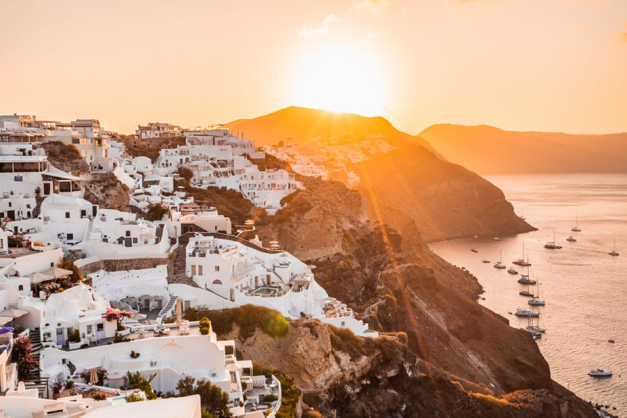 Sunrise over the white-washed buildings in Oia, Santorini