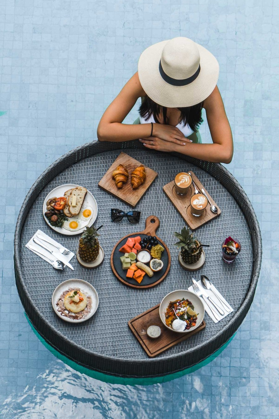 Girl with a floating breakfast at Cabina Bali