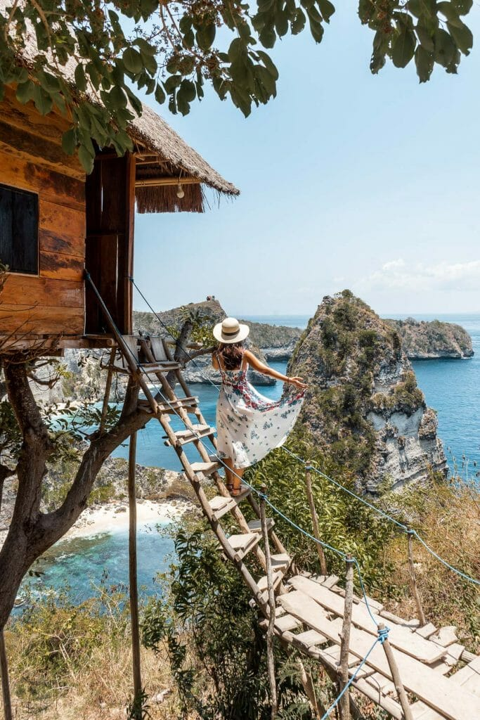 Girl standing on the stairway at Rumah Pohon Treehouse, Nusa Penida