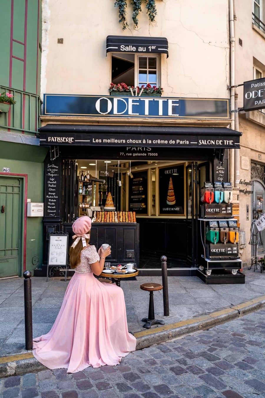 Girl in a pink dress sitting in front of Odette Paris