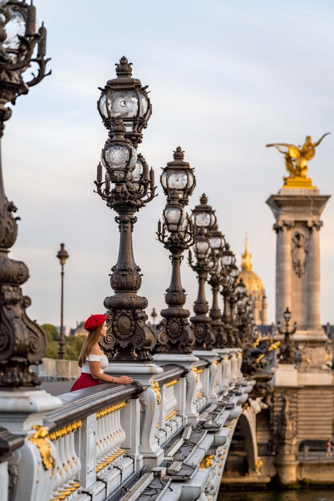 Girl standing at Pont Alexandre III, one of the best Paris Instagram spots
