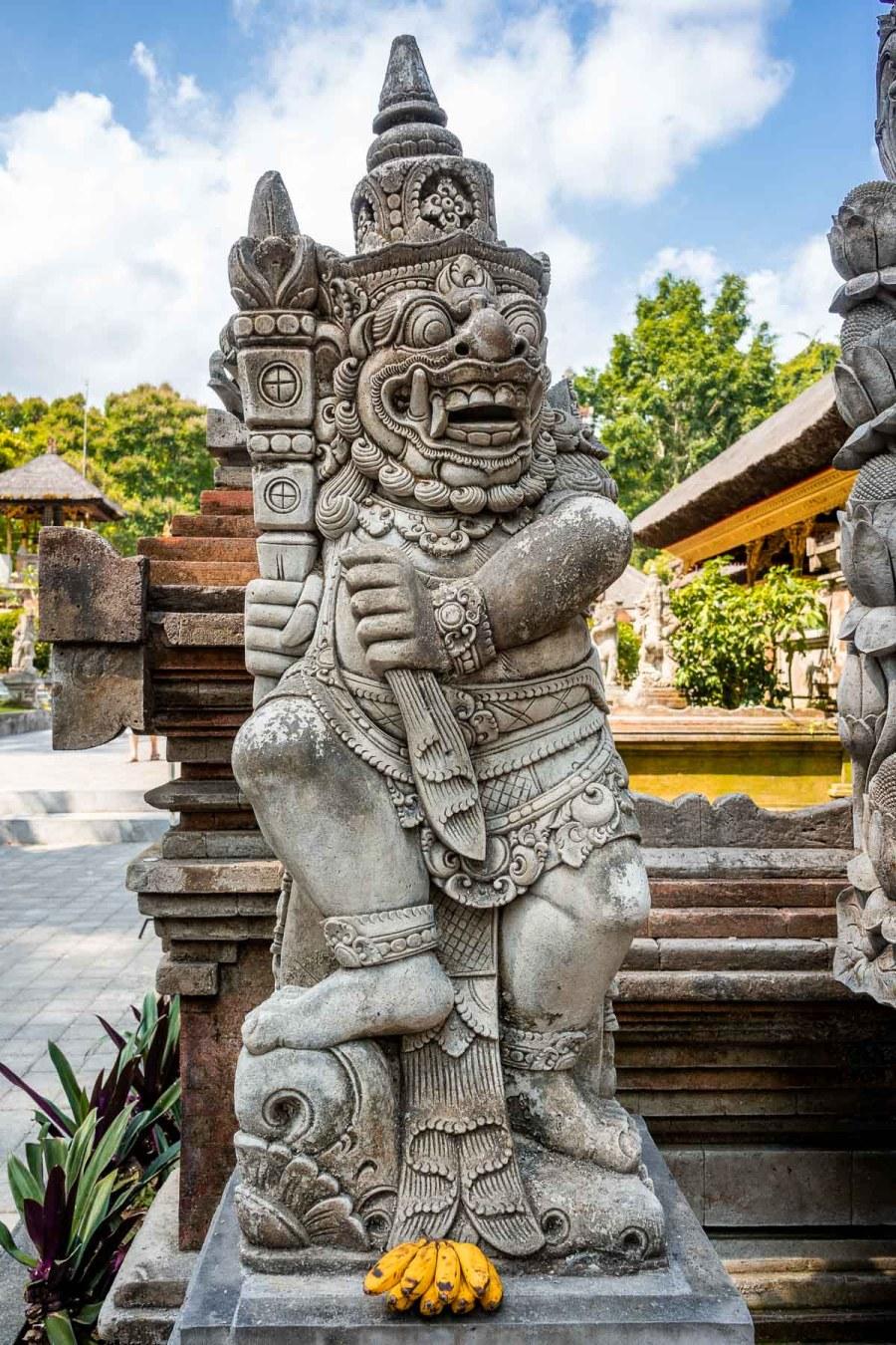 Stone statue at Pura Tirta Empul Temple in Bali
