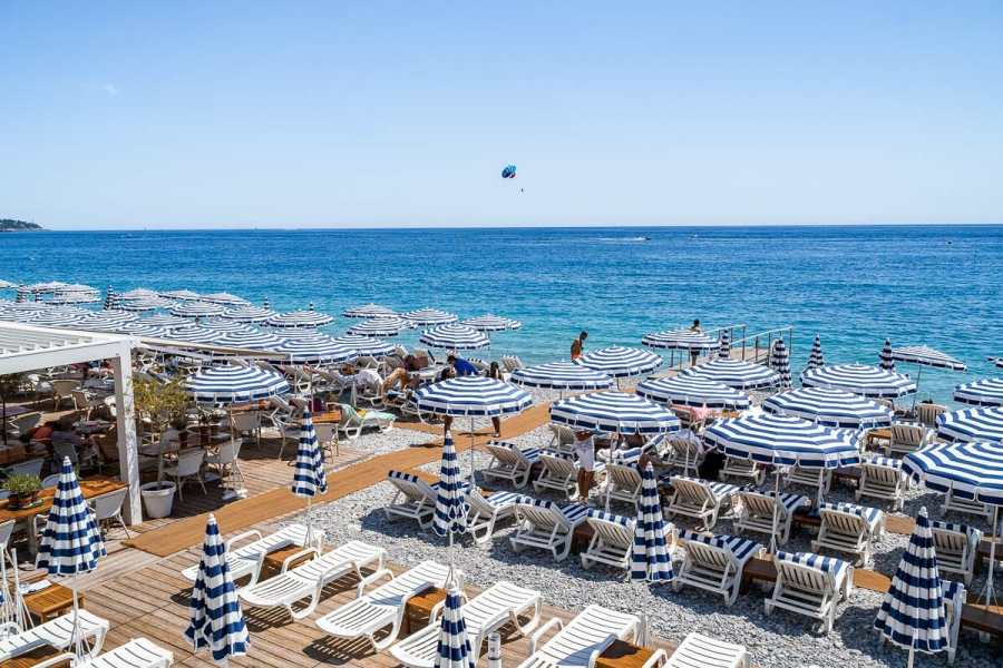 The famous white-blue parasols at Ruhl Plage in Nice, France