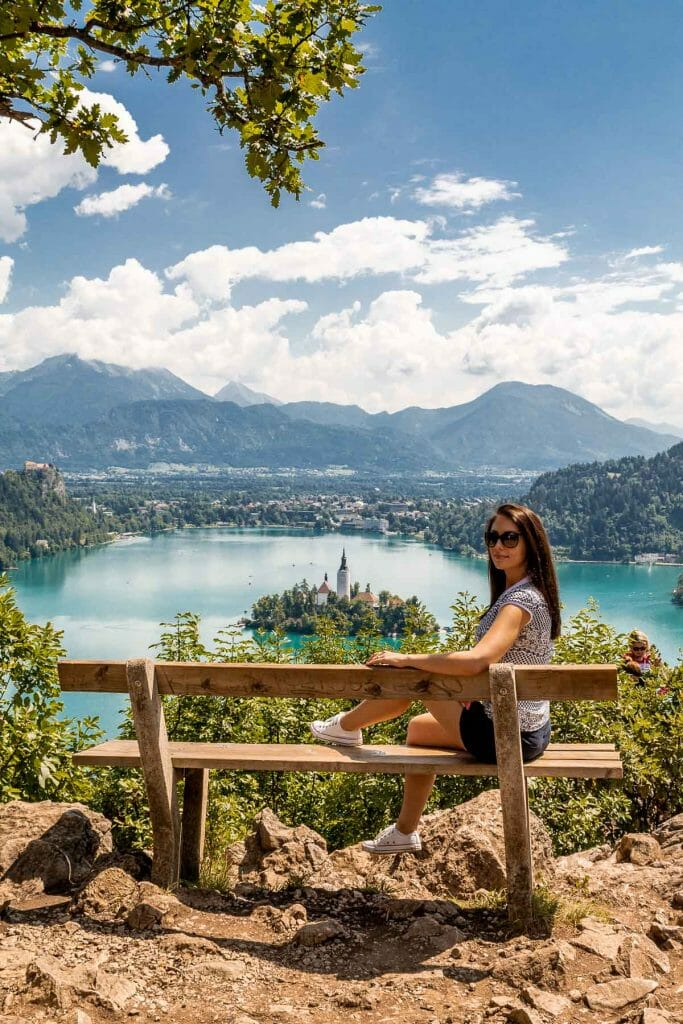 Girl sitting on a bench at a scenic viewpoint in Lake Bled, Slovenia