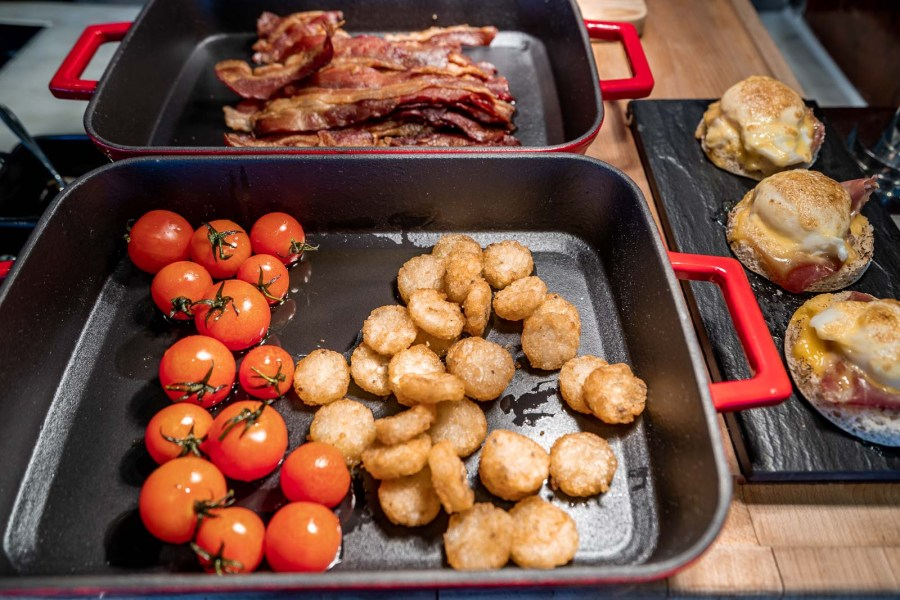 Fried potatos, tomatoes and bacon slices for breakfast