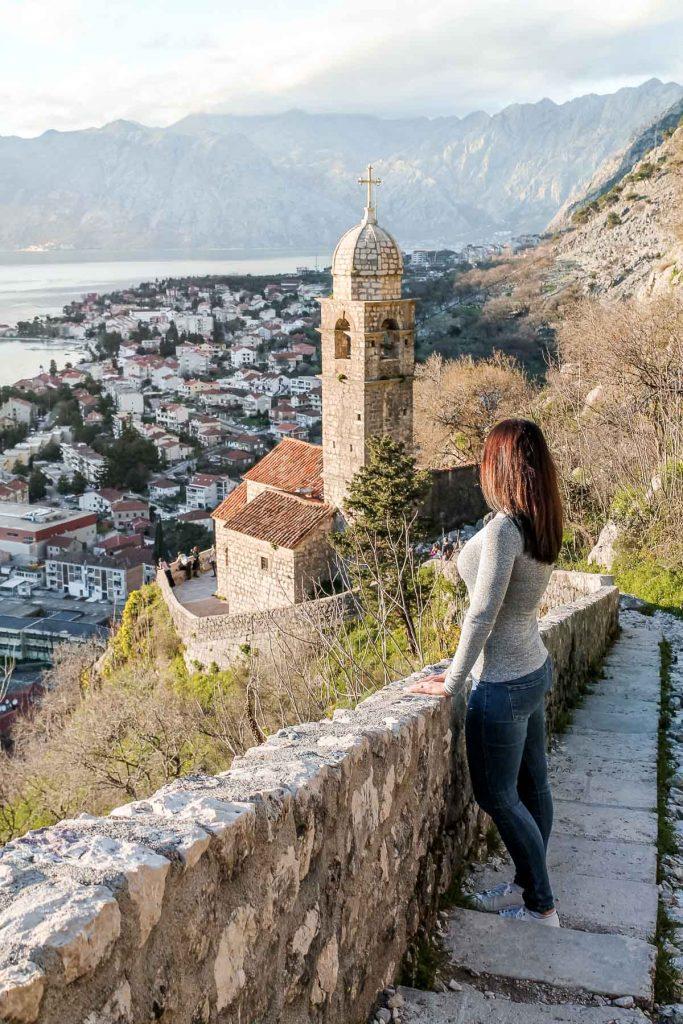 Girl standing on a stairway in Kotor, Montenegro