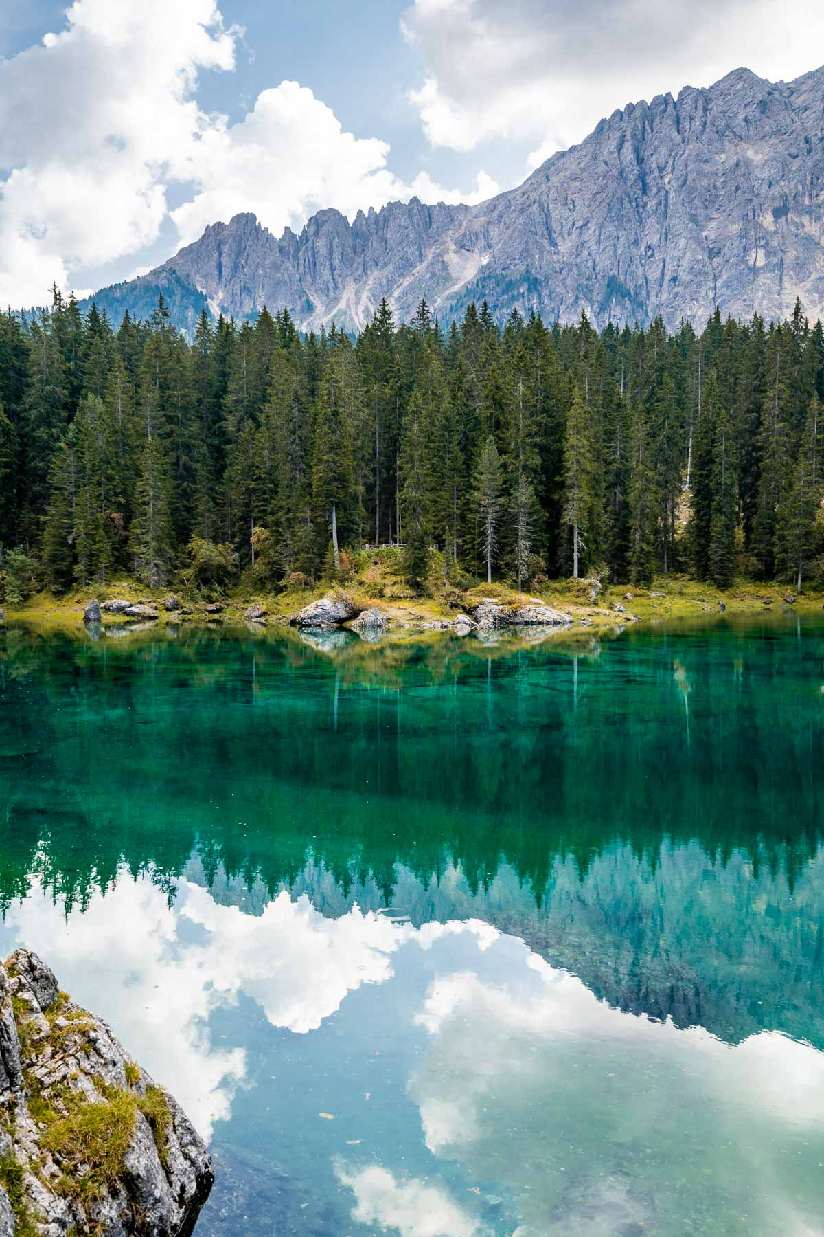 Reflections at Lago di Carezza, one of the most beautiful lakes in the Dolomites