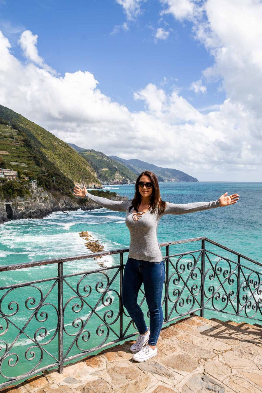 Panoramic sea view with girl in the middle at Monterosso al Mare in Cinque Terre, Italy